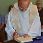 Fr. Byron finalizes the entrance ceremony by signing the house journal