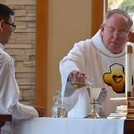 Dn. David prepares the altar for the Eucharist