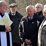 Fr. Ed speaks with members of the family at the mausoleum
