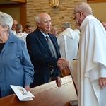 Fr. Ed shares the Sign of Peace with Fr. Steve