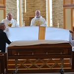 Fr. Terry and Fr. David fold the pall