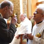 Fr. Bob shares the cup
