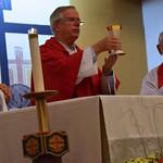 Fr. Giovani Pontes, Fr. John van den Hengel and Fr. Richard Woodbury celebrate Mass with the parish community