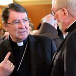 The archbishop speaks with Fr. Ed Kilianski, US provincial superior