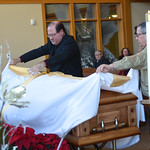 Br. Duane and Br. Frank place the pall