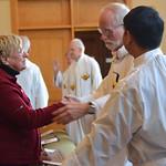 Fr. Ed greets a member of Br. Ben